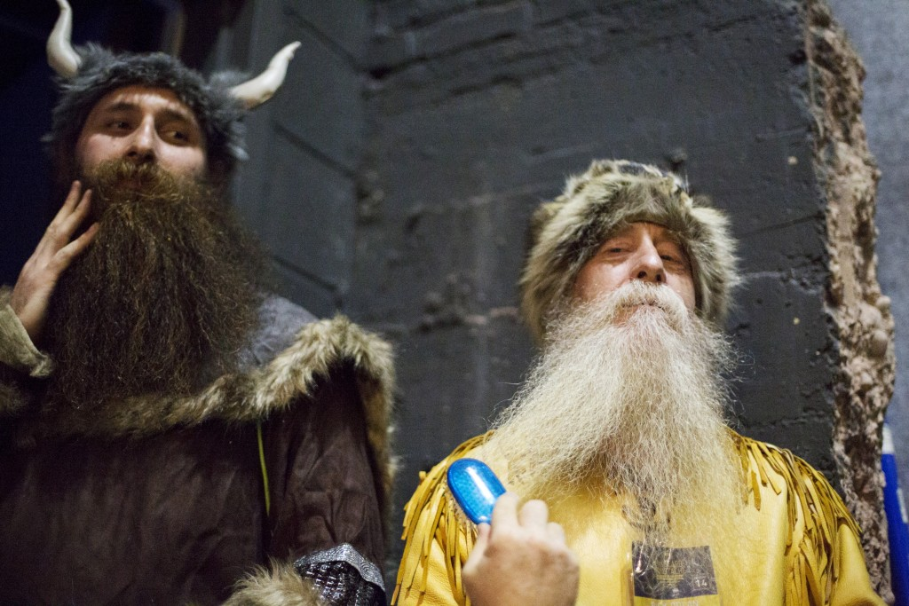 Contestants groom their beards backstage. Photo by Elizabeth Shafiroff/Reuters