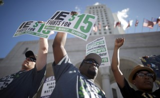 Fast-food workers and their supporters join a nationwide protest for higher wages and union rights outside City Hall in Los Angeles, California, United States, November 10, 2015. REUTERS/Lucy Nicholson - RTS6DLH