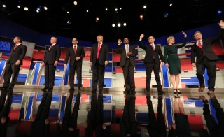 Republican presidential candidates greeted the audience before the GOP debate on Nov. 10. Photo by  Darren Hauck/Reuters