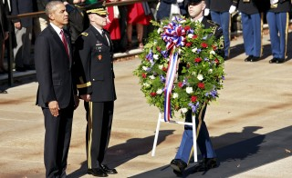 President Barack Obama prepares to lay a wreath at the Tomb of the Unknown Soldier on Veterans Day at Arlington National Cemetery in Virginia on Nov. 11. Photo by Kevin Lamarque/Reuters