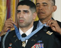 U.S. President Barack Obama presents retired Army Captain Florent Groberg, 32, with the Medal of Honor during a ceremony at the White House in Washington November 12, 2015. Groberg received the Medal of Honor for his courageous actions while serving as a personal security detachment commander during combat operations in Kunar Province, Afghanistan on August 8, 2012. REUTERS/Kevin Lamarque - RTS6OL8