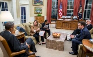 President Barack Obama is briefed on the Nov. 13 Paris attacks by Lisa Monaco (2nd L), Assistant to the President for Homeland Security and Counter-terrorism, in the White House Oval Office in Washington, DC November 13, 2015. The attacks give a new urgency to meeting of world leaders at the G-20 summit in Turkey. Photo by Reuters/White House handout