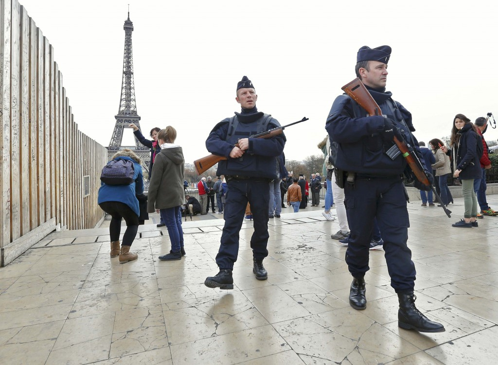 Police patrol near the Eiffel Tower the day after a series of deadly attacks in Paris on Nov. 14. Photo by Yves Herman/Reuters