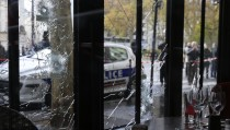 Bullet impacts are seen in the window of a restaurant window the day after a series of deadly attacks in Paris , November 14, 2015. Photo by Pascal Rossignol/Reuters