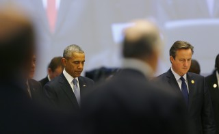 U.S. President Barack Obama, British Prime Minister David Cameron (R) and leaders of the Group of 20 major economies observe minutes silence in memory of the Paris attacks before a working session at the G20 summit in the Mediterranean resort city of Antalya, Turkey, November 15, 2015. Photo by Murad Sezer/Reuters
