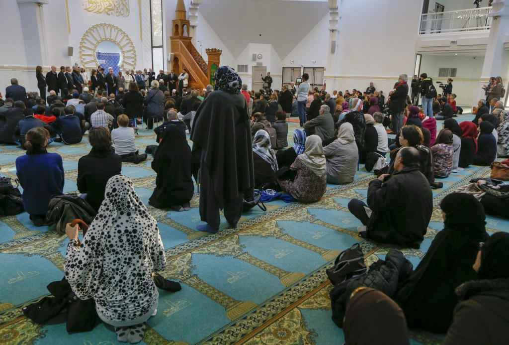 Several hundred people, Muslims and non-Muslims, gather to pray at the Grande Mosque in Lyon, France, November 15, 2015, for the victims of the series of shootings in Paris on Friday. Photo by Robert Pratta/Reuters