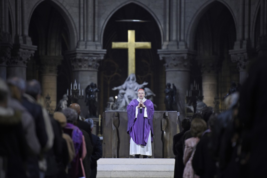 The Archbishop of Paris, Andre Vingt-Trois says mass at the Notre Dame Cathedral in Paris, France, November 15, 2015, in homage to the victims of a series of fatal shootings in the French capital on Friday. Photo by Lionel Bonaventure/Reuters