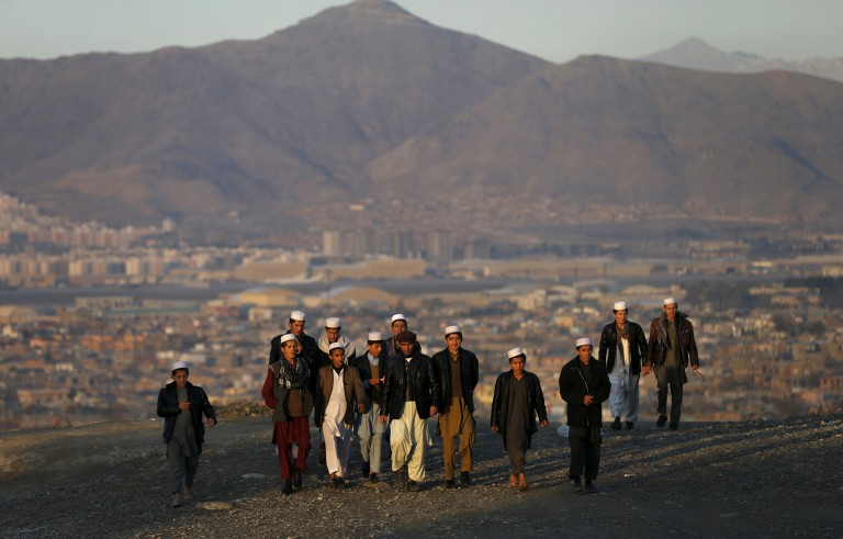 People climb a hill to watch the sunset in Kabul, Afghanistan on Nov. 16. Photo by Mohammad Ismail/Reuters
