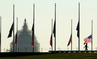 Flags on the National Mall are seen flying at half staff in Washington Monday. President Barack Obama issued a proclamation ordering flags to fly at half staff as a mark of respect for victims of the Paris attacks. Photo by Kevin Lamarque/Reuters