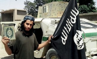 An undated photograph of a man described as Abdelhamid Abaaoud that was published in the Islamic State's online magazine Dabiq and posted on a social media website. The Belgian national is suspected of being behind Friday's attacks in Paris. Photo from social media via Reuters