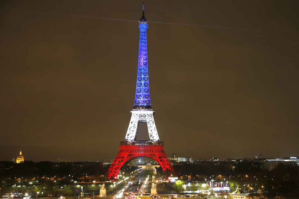 The Eiffel Tower is lit with the blue, white and red colours of the French flag in Paris, France, November 16, 2015, to pay tribute to the victims of a series of deadly attacks on Friday in the French capital. Photo by Charles Platiau/Reuters