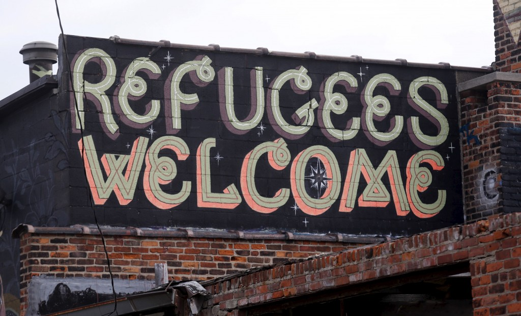 """Refugees Welcome"" is seen painted on a building in a blighted area near downtown Detroit, Michigan November 17, 2015. Photo by Rebecca Cook/Reuters"