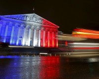 The National Assembly is lit with the blue, white and red colours of the French flag in Paris, France, November 19, 2015, to pay tribute to the victims of a series of deadly attacks that occurred last Friday in the French capital.  REUTERS/Jacky Naegelen  - RTS80KK