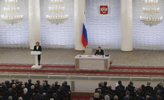 Chairwoman of the Russian Federation Council Valentina Matviyenko delivers a speech during a joint meeting of chambers of Russia's parliament to discuss a fight against terrorism, with State Duma speaker Sergey Naryshkin seen nearby, in Moscow, Russia November 20, 2015. Russian lawmakers will on Friday propose tougher punishment for terrorists and discuss introducing a raft of new security measures at a rare meeting of both chambers of parliament, Russian news agencies reported, citing a draft law. REUTERS/Maxim Zmeyev - RTS82AF