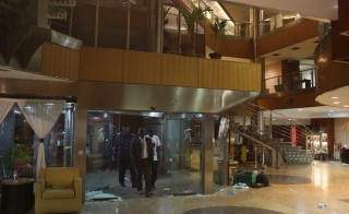 Malian officials enter the lobby of the Radisson hotel in Bamako, Mali, November 20, 2015. Photo by Joe Penney/Reuters.
