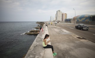 U.S. medical student Yasemin Lawson, 35, accesses the Internet at a Wi-Fi hotspot in Cuba's capital Havana on Sept. 22, 2015. Cuba now has 35 nationwide Wi-Fi hotspots with more promised soon. Photo by Alexandre Meneghini/Reuters