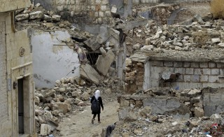 A school girl walks past damaged buildings in the rebel-controlled area of Maaret al-Numan town in Idlib province, Syria on Oct. 28, 2015. According to a new poll by the Associated Press, more than six in 10 Americans now reject President Barack Obama's approach to fighting the Islamic State militants. Photo by Khalil Ashawi/Reuters