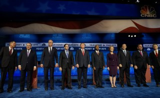 Republican presidential candidates pose before the start of the 2016 Republican presidential candidates debate held by CNBC in Boulder, Colorado, October 28, 2015. The candidates' dissatisfaction with aspects of that debate prompted a private meeting between campaigns that aims to improve upcoming debates. Photo by Rick Wilking/Reuters