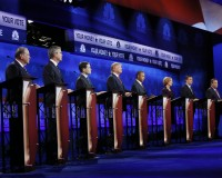 Republican U.S. presidential candidates (L-R) Governor John Kasich, former Governor Mike Huckabee, former Governor Jeb Bush, U.S. Senator Marco Rubio, businessman Donald Trump, Dr. Ben Carson, former HP CEO Carly Fiorina, U.S. Senator Ted Cruz, Governor Chris Christie and U.S. Rep. Rand Paul participate in the 2016 U.S. Republican presidential candidates debate held by CNBC in Boulder, Colorado, October 28, 2015. REUTERS/Rick Wilking  - RTX1TQ26