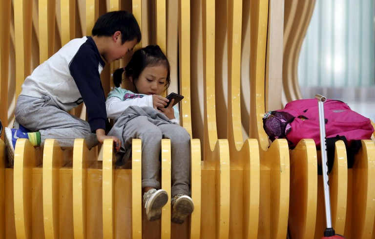 Zhou Ziwei plays with his cousin at a shopping mall in Beijing, China October 30, 2015. Wang Yi, 34, an office worker, the mother of the five-year-old Zhou Ziwei said she does not want to have a second child because it takes efforts to raise her son. She does not expect the rule change bring more childbirths in China because many of her friends have hesitated to have second child since the implement of the one-child policy last time, as raising children requires a lot of effort. China has unwound its one-child policy, for decades a symbol of invasive and coercive government planning, but the shift has been met with a disinterested shrug from many younger couples. REUTERS/Kim Kyung-Hoon - RTX1TXVC