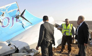Egypt's Prime Minister Sherif Ismail (right) observes the remains of a Russian airliner after it crashed in central Sinai near El Arish city, north Egypt, on Oct. 31. Photo by Stringer/Reuters