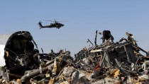 An Egyptian military helicopter flies over debris from a Russian airliner which crashed at the Hassana area in Arish city, north Egypt, November 1, 2015. Russia has grounded Airbus A321 jets flown by the Kogalymavia airline, Interfax news agency reported on Sunday, after one of its fleet crashed in Egypt's Sinai Peninsula, killing all 224 people on board. REUTERS/Mohamed Abd El Ghany - RTX1U8F2