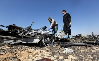 Military investigators from Russia check debris from a Russian airliner at its crash site at the Hassana area in Arish city, north Egypt, November 1, 2015. Russia has grounded Airbus A321 jets flown by the Kogalymavia airline, Interfax news agency reported on Sunday, after one of its fleet crashed in Egypt's Sinai Peninsula, killing all 224 people on board. REUTERS/Mohamed Abd El Ghany - RTX1U8GM