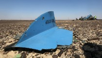 The debris from a Russian airliner is seen at its crash site at the Hassana area in Arish city, north Egypt, November 1, 2015. Russia has grounded Airbus A321 jets flown by the Kogalymavia airline, Interfax news agency reported on Sunday, after one of its fleet crashed in Egypt's Sinai Peninsula, killing all 224 people on board. REUTERS/Mohamed Abd El Ghany - RTX1U8H1