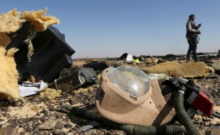 A debris from a Russian airliner is seen at its crash site at the Hassana area in Arish city, north Egypt, November 1, 2015. Russia has grounded Airbus A321 jets flown by the Kogalymavia airline, Interfax news agency reported on Sunday, after one of its fleet crashed in Egypt's Sinai Peninsula, killing all 224 people on board. REUTERS/Mohamed Abd El Ghany - RTX1U8KN