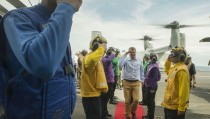 U.S. Navy sailors salute as U.S. Secretary of Defense Ash Carter (C) as he and Malaysian Minister of Defense Hishammuddin Hussein (Not Pictured) arrive aboard the USS Theodore Roosevelt aircraft carrier in the South China Sea, in this handout photograph taken and released on November 5, 2015. REUTERS/Senior Master Sgt. Adrian Cadiz/Department of Defense/Handout FOR EDITORIAL USE ONLY. NOT FOR SALE FOR MARKETING OR ADVERTISING CAMPAIGNS - RTX1UXES