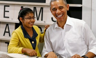 U.S. President Barack Obama smiles with a 16-year old refugee, a victim of human trafficking who will soon be resettled in the U.S., as he tours the Dignity for Children Foundation, an education program for refugee children, in Kuala Lumpur, Malaysia November 21, 2015. Photo by Jonathan Ernst/Reuters.