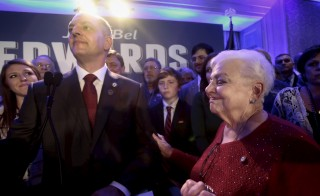 Democratic Louisiana Governor-elect John Bel Edwards, flanked by his mother, Dora Jean Edwards,  addresses supporters after defeating GOP Sen. David Vitter in a runoff election, New Orleans, November 21, 2015. Edwards will be Louisiana's first Democratic governor in eight years. Photo by Lee Celano/Reuters