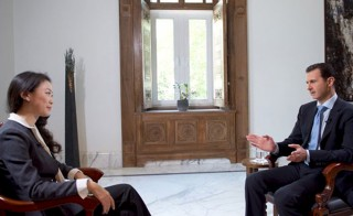Syrian President Bashar Assad speaks during an interview with the Chinese Phoenix Television Channel, Damascus, November 22, 2015. Despite U.S. calls for Assad to step down, the embattled Syrian president appears poised to outlast President Barack Obama in office. Photo by Reuters via Syrian Arab News Agency