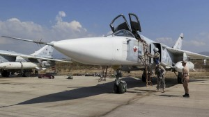 Pilots of a Russian Sukhoi Su-24 fighter jet prepare before a flight at the Hmeymim air base near Latakia, Syria, in this handout photograph released by Russia's Defence Ministry October 5, 2015. Turkish fighter jets shot down a Russian-made warplane near the Syrian border on November 24, 2015 after repeatedly warning it over air space violations, Turkish officials said, but Moscow said it could prove the jet had not left Syrian air space.  REUTERS/Ministry of Defence of the Russian Federation/Handout via Reuters ATTENTION EDITORS - THIS PICTURE WAS PROVIDED BY A THIRD PARTY. REUTERS IS UNABLE TO INDEPENDENTLY VERIFY THE AUTHENTICITY, CONTENT, LOCATION OR DATE OF THIS IMAGE. THIS PICTURE IS DISTRIBUTED EXACTLY AS RECEIVED BY REUTERS, AS A SERVICE TO CLIENTS. EDITORIAL USE ONLY. NOT FOR SALE FOR MARKETING OR ADVERTISING CAMPAIGNS. NO RESALES. NO ARCHIVE. - RTX1VKF8