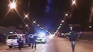 Laquan McDonald (R) walks on a road before he was shot 16 times by police officer Jason Van Dyke in Chicago, in this still image taken from a police vehicle dash camera video shot on October 20, 2014, and released by Chicago Police on November 24, 2015. Van Dyke, a white Chicago policeman was charged on Tuesday with murdering black teenager McDonald, a prosecution that was speeded up in hopes of staving off a fresh burst of the turmoil over race and police use of deadly force that has shaken the U.S. for more than a year. REUTERS/Chicago Police Department/Handout via Reuters       TPX IMAGES OF THE DAY     ATTENTION EDITORS - THIS IMAGE HAS BEEN SUPPLIED BY A THIRD PARTY. FOR EDITORIAL USE ONLY. NOT FOR SALE FOR MARKETING OR ADVERTISING CAMPAIGNS. THIS PICTURE WAS PROCESSED BY REUTERS TO ENHANCE QUALITY. AN UNPROCESSED VERSION WILL BE PROVIDED SEPARATELY. - RTX1VP9R