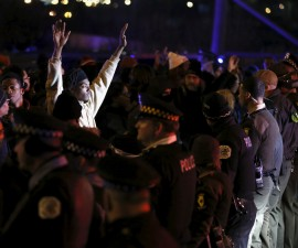 Protesters demonstrate after the release of a video showing the shooting of Laquan McDonald, in Chicago, Illinois November 24, 2015. McDonald, 17, was fatally shot by a Chicago police officer in October 2014. REUTERS/Andrew Nelles - RTX1VQ4X