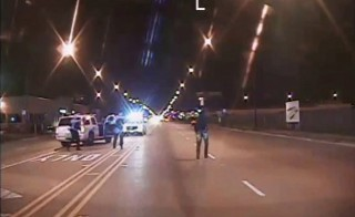 Laquan McDonald (R) walks on a road before he was shot 16 times by police officer Jason Van Dyke in Chicago, in this still image taken from a police vehicle dash camera video shot on October 20, 2014, and released by Chicago Police on November 24, 2015. Van Dyke, a white Chicago policeman was charged on Tuesday with murdering black teenager McDonald, a prosecution that was speeded up in hopes of staving off a fresh burst of the turmoil over race and police use of deadly force that has shaken the U.S. for more than a year. REUTERS/Chicago Police Department/Handout via Reuters ATTENTION EDITORS - THIS IMAGE HAS BEEN SUPPLIED BY A THIRD PARTY. FOR EDITORIAL USE ONLY. NOT FOR SALE FOR MARKETING OR ADVERTISING CAMPAIGNS. IT IS DISTRIBUTED, EXACTLY AS RECEIVED BY REUTERS, AS A SERVICE TO CLIENTS - RTX1VS7J