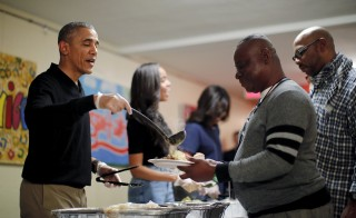 President Barack Obama and his family serve thanksgiving dinner at Friendship Place Homeless Center at the St. Luke's Methodist church in Washington. Photo by Carlos Barria/Reuters