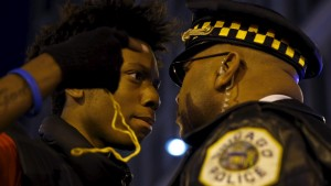 Protestors including Lamon Reccord, 16, confront police during a demonstration in response to the fatal shooting of Laquan McDonald in Chicago, Illinois November 25, 2015. Laquan McDonald, 17, was fatally shot by Jason Van Dyke, a Chicago police officer, in October 2014. REUTERS/Andrew Nelles      TPX IMAGES OF THE DAY      - RTX1VV8X