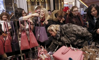 Go ahead, buy that 20 percent-off handbag at Macy's. Photo by Andrew Kelly/Reuters