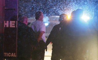 A suspect, identified as Robert Lewis Dear, is taken into custody outside a Planned Parenthood center in Colorado Springs, Colorado on Nov. 27, 2015. Dear is accused of opening fire in the clinic Friday, killing three people and wounding eight others, authorities said. Photo by Isaiah J. Downing/Reuters