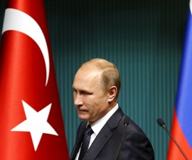Russian President Vladimir Putin arrives for a news conference at the Presidential Palace in Ankara, Turkey in this December 1, 2014 file photo. Putin signed a decree imposing economic sanctions against Turkey on Saturday, four days after Turkey shot down a Russian warplane near the Syrian-Turkish border. REUTERS/Umit Bektas/Files - RTX1W9MQ