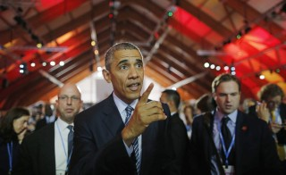 U.S. President Barack Obama walks in the main conference hall during the opening ceremony of the World Climate Change Conference 2015 (COP21) at Le Bourget, near Paris, France, November 30, 2015.    REUTERS/Stephane Mahe - RTX1WH5W