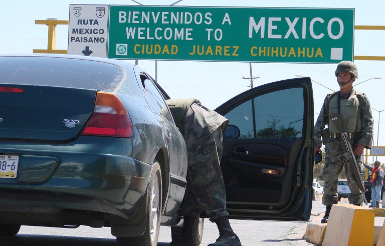 Soldiers inspect a car outside the Cordova-Americas international border crossing bridge in the border city of Ciudad Juarez. A new study shows that more Mexicans are leaving than coming to the U.S. Photo by Alejandro Bringas/Reuters