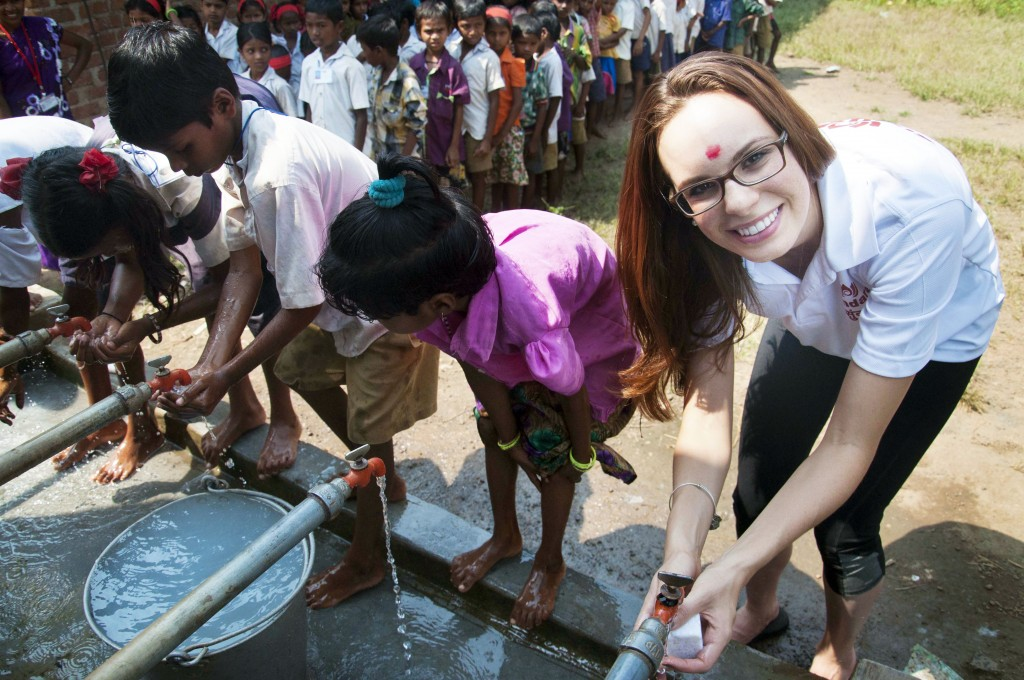 Erin Zaikis (right) washes her hands with children in Shilonda, India, one of the countries where Sundara promotes the use of soap. Photo by Emily Rose Weinstein