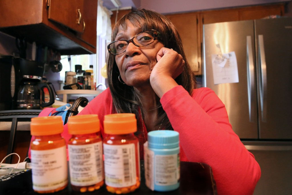 Denise Scott, 66, of Cleveland, Ohio, gets a subsidy from Medicare to help her pay for some of her prescription drugs. But, next year, some a premium increase may mean some low-income Medicare drug beneficiaries must pay a larger share for their medicine. Photo by Lynn Ischay/Kaiser Health News