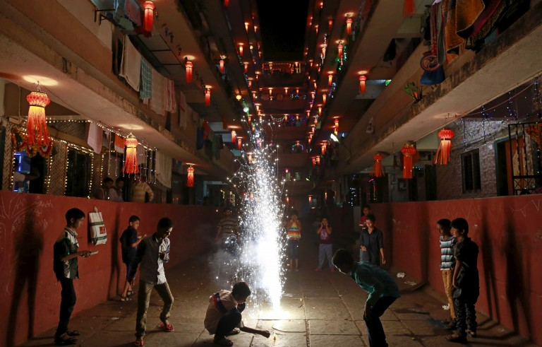 Children play with firecrackers while celebrating the Hindu festival of Diwali, the annual festival of lights in Mumbai, India, on Nov. 11. Photo by Danish Siddiqui/Reuters