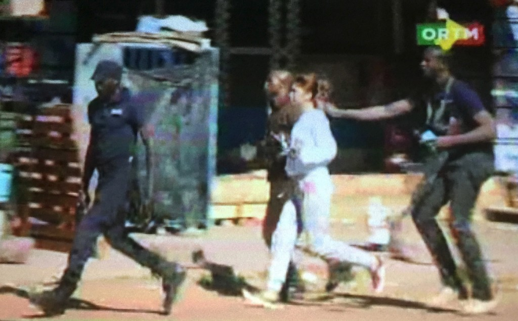 Image from a video shows a hostage rushed out of the Radisson hotel in Bamako, Mali, on Nov. 20. Gunmen shouting Islamic slogans attacked a luxury hotel full of foreigners in Mali's capital Bamako early on Friday morning, taking 170 people hostage, a senior security source and the hotel's operator said. Image from Reuters TV
