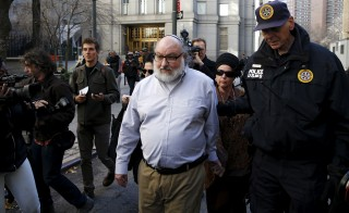 Convicted Israeli spy Jonathan Pollard (center), who was released from a U.S. federal prison in North Carolina overnight, leaves U.S. District court with his wife Elaine Zeitz (second from right) in the Manhattan borough of New York on Nov. 20. Pollard was sentenced to life in prison after being convicted in 1987 of passing classified information to Israel while he was working as a US Navy analyst. Photo by Mike Segar/Reuters