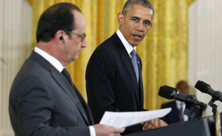 U.S. President Barack Obama (right) and French President Francois Hollande hold a joint news conference in the East Room of the White House in Washington on Nov. 24. Photo by Jonathan Ernst/Reuters